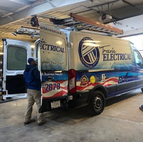 Man checking inside the Travis Electrical van