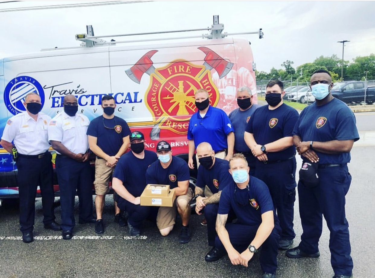 Fire rescue team with Travis Electrical van